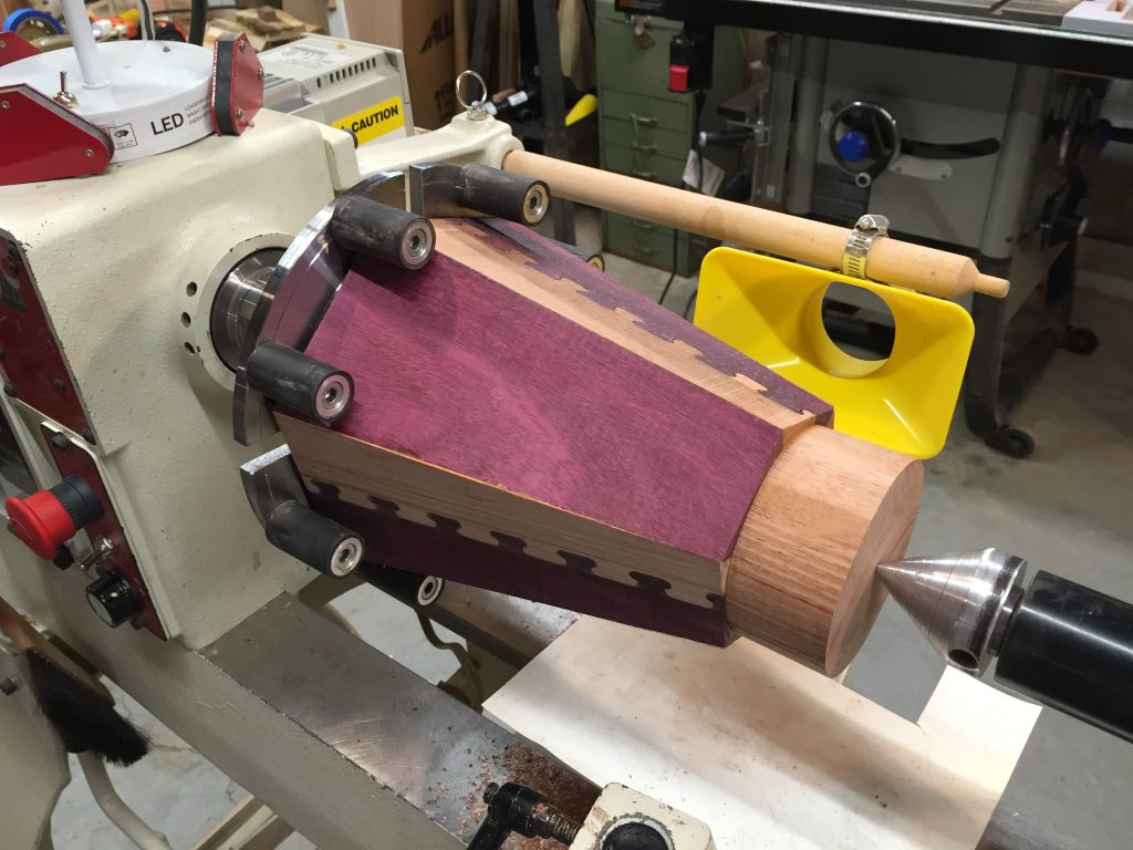 Transferring the dovetail vase to a lathe.