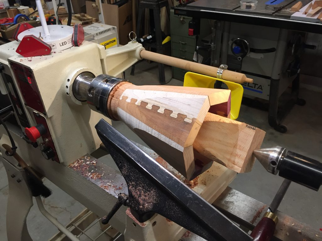 Cutting and sanding the outer surface of the dovetail tapered vase.
