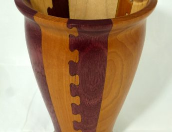 Finished, oiled, and polished dovetail joinery vase.