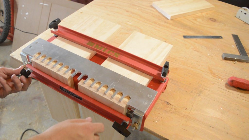 Clamping the parts of the MLCS Dovetail Jig to begin routing.